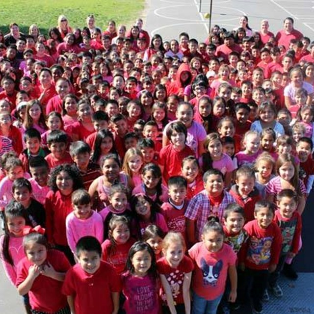 Students wear red and pink to form a healthy, yet adorable heart!