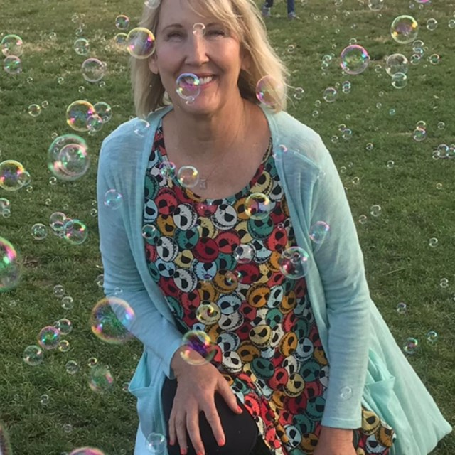 Principal Lynn Hardin embraces her inner-child in this sweet bubble photoshoot!